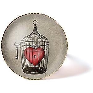 Ring mit Cabochon, Herz in einem Käfig