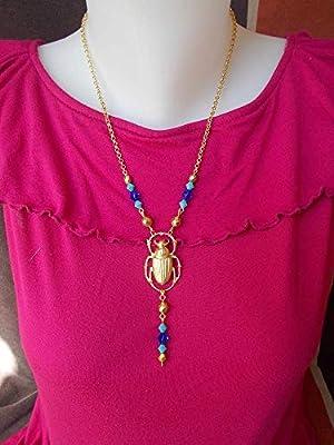 Collier égyptien à scarabée doré et cristal bleu ou tons topaze