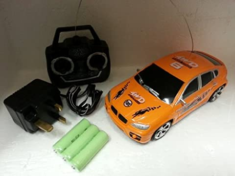 SPORTS MODEL RADIO CONTROLRECHARGABLE 1:24 SCALE /CAR WITH batterey pack and main charger colors red,orange and black