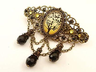 Pince à cheveux avec un motif d'arbre en bronze jaune noir