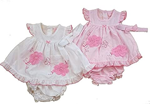 Rock-A-Bye-Baby Dress with polka dot and 3D rosette flower detailing. Cute baby girl pants and headband to match. Available to fit ages 0-9 months Pink or White (3-6 months, White)