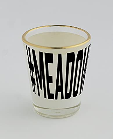Shot glass with gold rim of #MEADOW