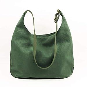 Grüne Schultertasche für Damen mit Reißverschluss. Tasche mit Taschen, verstellbarer Riemen