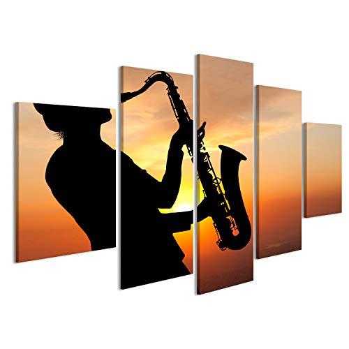islandburner Bild Bilder auf Leinwand Saxophonist. Frau spielt auf Saxophon vor dem Hintergrund des Sonnenuntergangs Wandbild, Poster, Leinwandbild EGV