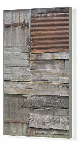 canvas-print-of-old-weather-beaten-rusty-corrugated-iron-siding-amidst-wooden-slats-on-a-hut