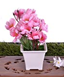 #10: Pindia Decorative Synthetic Fabric Artificial Baby Pink Flower Plant with Pot (14 cm x 10 cm x 17 cm)