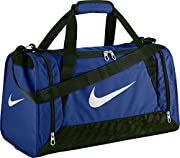 Nike Brasilia Grip Bag Features: Small holdall zipped main compartment 2 zipped side pockets Hook and loop tape internal pouch Adjustable, detachable shoulder strap Carry handles Name tag Nike branding Dimensions: H30cm x W49cm x D29cm Colour...