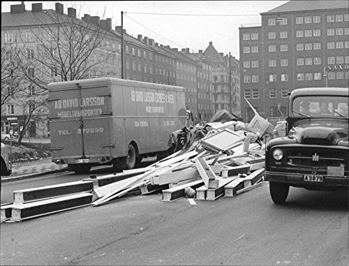 vintage-photo-of-tons-of-lumber-fell-out-of-the-truck-and-lay-on-car-road-in-central-stockholm