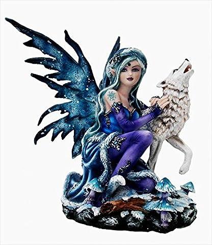 statuettedeco - Statuette fée hiver avec son loup blanc