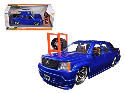 2002-124-scale-cadillac-escalade-ext-just-trucks-serial-with-extra-wheels-and-rack-blue-by-jada