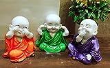 #8: Karigaari India Colorful Set of 03 Laughing Baby Buddha Showpiece Figurine (Orange, Purple, Green)