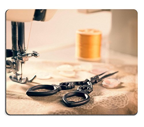 luxlady-mousepads-antique-scissors-on-fabric-against-vintage-sewing-machine-threaded-cotton-image-28