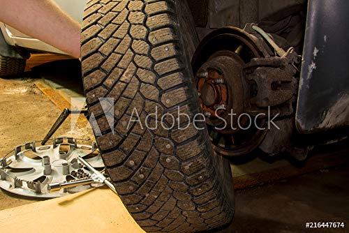 druck-shop24 Wunschmotiv: Mechanician Changing car Wheel in Garage. Man exchanging tire. Tire Service. Tire Fitting. #216447674 - Bild auf Alu-Dibond - 3:2-60 x 40 cm / 40 x 60 cm