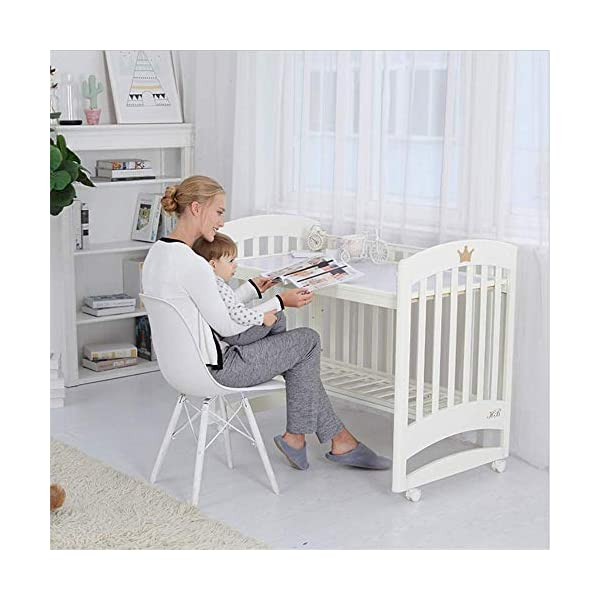 Solid Wooden Baby Cot,toddler Bed, Multifunctional White Cradle Bed Newborn Stitching, Height Adjustable HXYL Package contains bed, mosquito net, mosquito net pole, moving caster, kit Split panel for connecting to a large bed Three heights are adjustable to suit your child's different needs 4