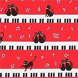 Rotes Wachstuch mit schwarzen Katzen, Noten und