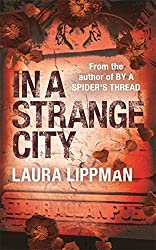 In a Strange City (A Tess Monaghan Investigation) by Laura Lippman (2002-08-01)