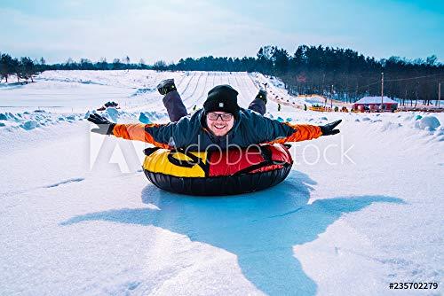 druck-shop24 Wunschmotiv: Man Snow tubing from Hill. Winter Activity Concept #235702279 - Bild auf Forex-Platte - 3:2-60 x 40 cm / 40 x 60 cm (Snow Tubing)