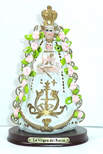 Virgen del Rocío. Medidas: 14,5x8,5x7 cms. aprox.. Elaborada en Resina policromada, con adornos de flores de tela.