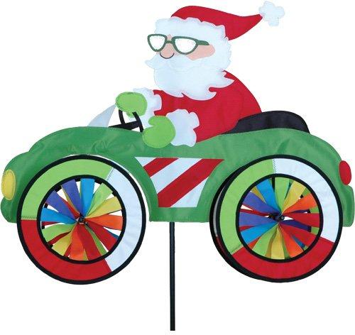 Girouette Père Noel voiture - décoration extérieure originale Père Noël - Eolienne de jardin, terrasse, balcon - Diamètre des roues : 20cm Dimension : 64cm x 50cm Hauteur : 110cm
