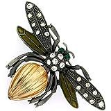 Piedra ámbar broche de insectos incrustados con cristales color esmeralda y ojos de cristal en un marco de marcasita. Tamaño: 7x 4,5cms.