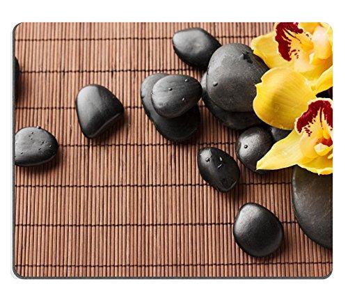 heath-and-mousepads-spa-beauty-concept-massaggio-con-fiori-per-orchidee-immagine-25690887-by-msd-sbi
