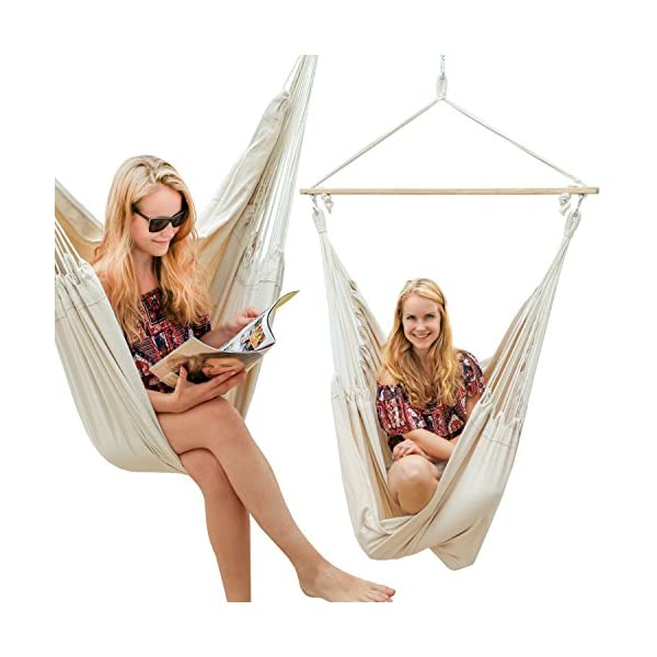 AMANKA Innovative XXL Swing Chair 185x130cm Hanging Seat made of cloth Beige AMANKA SAFER: INNOVATIVE ANTI-SLIP SYSTEM - no risk that the hammock slips off the spreader-bar: the ropes are firmly fixed to the wooden bar and the large canvas is hung with two sturdy metal hooks EXTRA LARGE PIECE OF CLOTH - the strong canvas is made of natural cotton. It is large approx. 185 x 130 cm, so there is plenty of space to sit and even lie down, both alone and in 2 people - suitable for adults and kids SINGLE-SPREADER BAR MADE OF WOOD - the longer the spreader bar, the more comfortable the hammock. Our four-square bar is 115 cm long! It will soon become your favorite spot for reading, dreaming and playing - perfect even as a children's swing 5