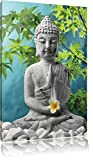 Buddha auf Steinen mit Monoi Blüte in der Hand , Format: 60x80 auf hochkantiges Leinwand, XXL riesige Bilder fertig gerahmt mit Keilrahmen, Kunstdruck auf Wandbild mit Rahmen, günstiger als Gemälde oder Ölbild, kein Poster oder Plakat