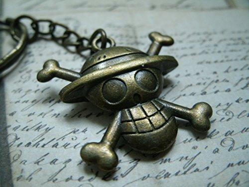 bronzo metallo portachiavi / collana che rappresenta il logo della One Piece