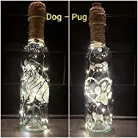 DOG PUG CLEAR. HAND ETCHED WINE BOTTLE, TRIMMED WITH TWINE AND CHARMS. LIGHTS