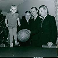 Vintage photo of Man standing, holding a ball in hand