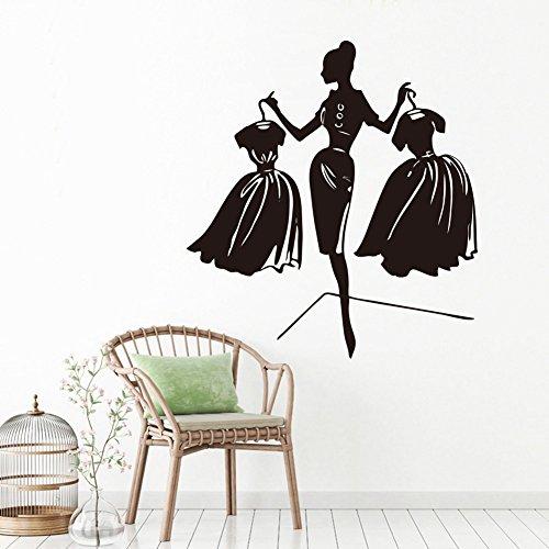 Pegatina pared vinilo silueta mujer con vestidos color negro 57 x 62 cm para vestidores habitaciones juveniles tiendas de ropa de OPEN BUY