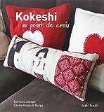 Kokeshi au point de croix