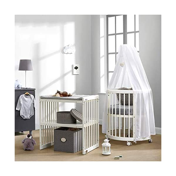 DUWEN Wooden Baby Cot European Multifunctional Small Round Bed Convertible To 3 Positions Toddler Bed Child Bed Sofa Bed Suitable For Cribs Under 6 Years(With Mattress and Bedding) DUWEN 【CONVERTIBLE CRIB】:Easy-to-change 3-in-1 cot can be easily converted from a crib to a nursing table and crib. The versatile crib will provide your child with a comfortable sleep. Beautifully designed cribs can grow with your child from infancy through childhood to adulthood. 【GROW UP WITH YOUR BABY】: The 3-bed mattress height adjustment function on the crib allows you to lower the mattress when your baby starts sitting or standing. It can keep your baby safe and comfortable in the bed that grows up with your baby. This convertible adjustable multifunctional bed will make your child's life unforgettable. 【STURDY PINE WOOD】: The crib is made of high-quality beech wood, which is sturdy and durable, bears more weight, has a carrying capacity of more than 150KG, is easy to assemble, and is designed for the healthy sleep of babies aged 0-6. 3D mousse growth mattress provides babies with comfortable and undisturbed sleep. 6