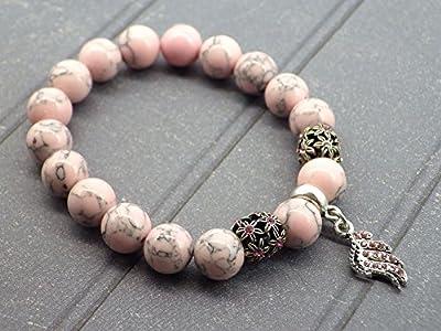 Bracelet pour femme en perles de turquoise rose reconstituée et charms en forme de plume avec cristaux