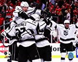 The Los Angeles Kings celebrate defeating the Chicago Blackhawks 5 to 4 in overtime of Game Seven to win the Western Conference Final of the 2014 Stanley Cup Playoffs at United Center on June 1 2014. Photo Print (40,64 x 50,80 cm)