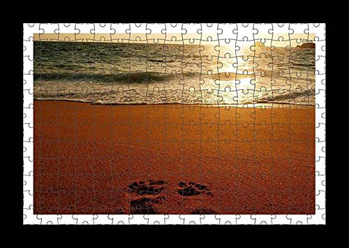 puzzle-style-pre-assembled-wall-print-of-foot-prints-on-sandy-beach-by-lisa-loft