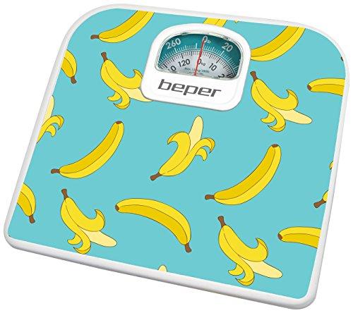 Báscula de baño analógica. Diseño con plátanos. Cuerpo de metal y plásticos ABS. Base de plástico ABS. Peso máximo de 130kg. Graduación de 1 kg. Rueda de calibrado.