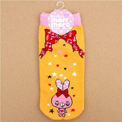 Imagen principal de calcetines con conejitos rosa y un lazo