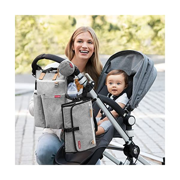 Skip Hop Pronto Signature Tote Bag, Grey Melange Skip Hop Front zipper pocket for keys, wallet, phone, and personal items Drop it in any bag, strap it to your wrist or clip it to your stroller Pronto pillow keeps baby's head comfy 10
