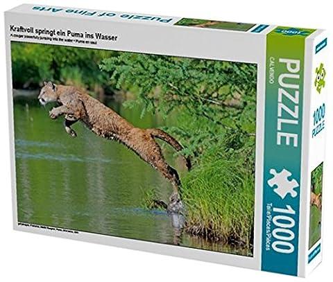 Kraftvoll springt ein Puma ins Wasser 1000 Teile Puzzle quer (CALVENDO Tiere)
