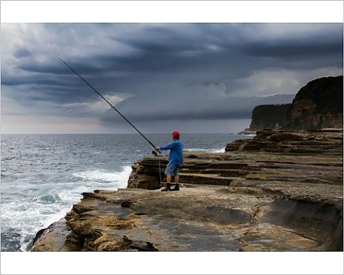 photographic-print-of-lone-fisherman-watches-approaching-storm
