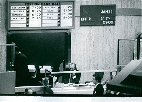 vintage-photo-of-wall-chart-at-the-london-stock-exchange-showing-the-bank-rates-in-other-important-m