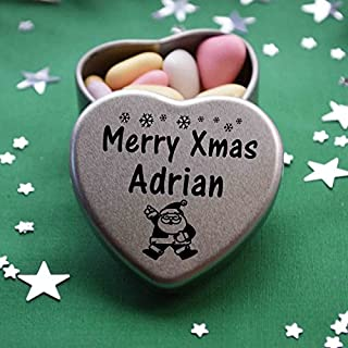 Merry Xmas Adrian Mini Heart Gift Tin with Chocolates Fits Beautifully in the palm of your hand. Great Christmas Present for Adrian Makes the perfect Stocking Filler or Card alternative. Tin Dimensions 45mmx45mmx20mm. Three designs Available, Father Christmas, Snowman and Snowflakes. They also make perfect Secret Santa Gifts.