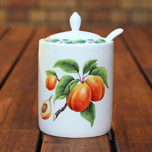 Moderne Marmeladendose und Löffel, Apricot