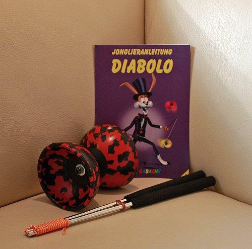 Diabolo Set Harlekin medium zweifarbig schwarz/rot mit Alu-Handstäben und Spielanleitung