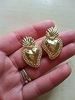 orecchini in ottone oro lavorato a mano con chiusura a vite della dimensione di 3cm circa. molto luminosi ed eleganti.