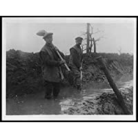 POSTER Clearing away mud on the Somme Two soldiers standing knee deep in liquid a trench Somme. They have bowl-shaped shovels with long handles, which Scotland Wall Art Print A3 replica