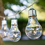 Guirnalda de 6 bombillas con estrellinas LED en su interior, a pilas, 1,5 m, Ø 55 x h 95 mm, Micro LED luz cálida, luces a pilas, luces navideñas