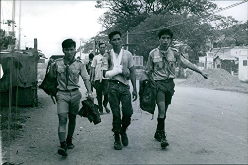 vintage-photo-of-men-walking-in-the-street-one-injured-during-vietnam-saigon-war-1968