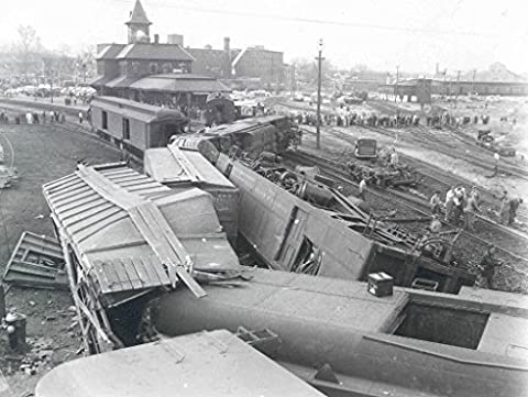 POSTER wreck Boston Maine train #302 November 13 1954 Object number A 2009 49 Medium paper photo emulsion Wreckage Boston & Maine train #302 Red Wing just outside Nashua New Hampshire train station train had been traveling at a high rate speed derailed a curve entering station locomotives derailed hitting freight cars an adjacent siding as they moved A female passenger was kille